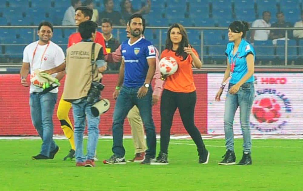 Dinesh Karthik and Parineeti Chopra during a match between Delhi Dynamos and Chennaiyin FC in Indian Super League (ISL) football match in New Delhi.