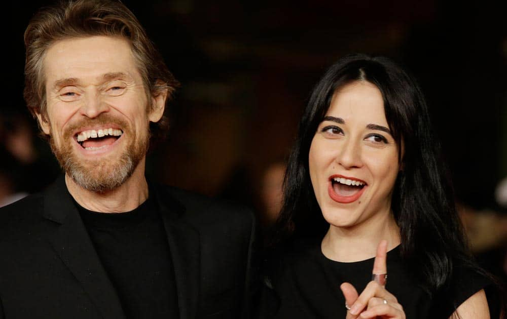 Actor Willem Dafoe pose with his wife Giada Colagrande as they arrive on the red carpet on the occasion of the screening of the movie 'The Most Wanted Man' during the 9th edition of the Rome Film Festival in Rome.