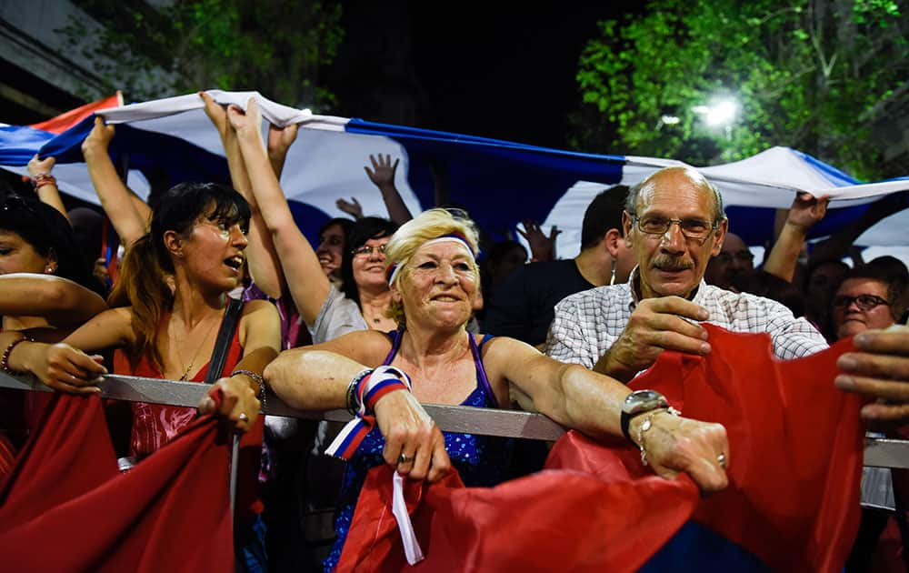 Supporters of Presidential candidate for the ruling Broad Front party Tabare Vazquez celebrate after Uruguay's polling stations closed during general elections in Montevideo, Uruguay.