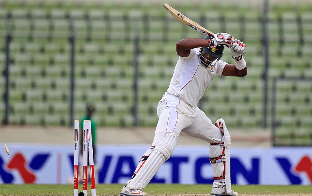 Zimbabwe's Hamilton Masakadza is bowled out by Bangladesh's Shahadat Hossain during the third day of the first cricket test match in Dhaka, Bangladesh.