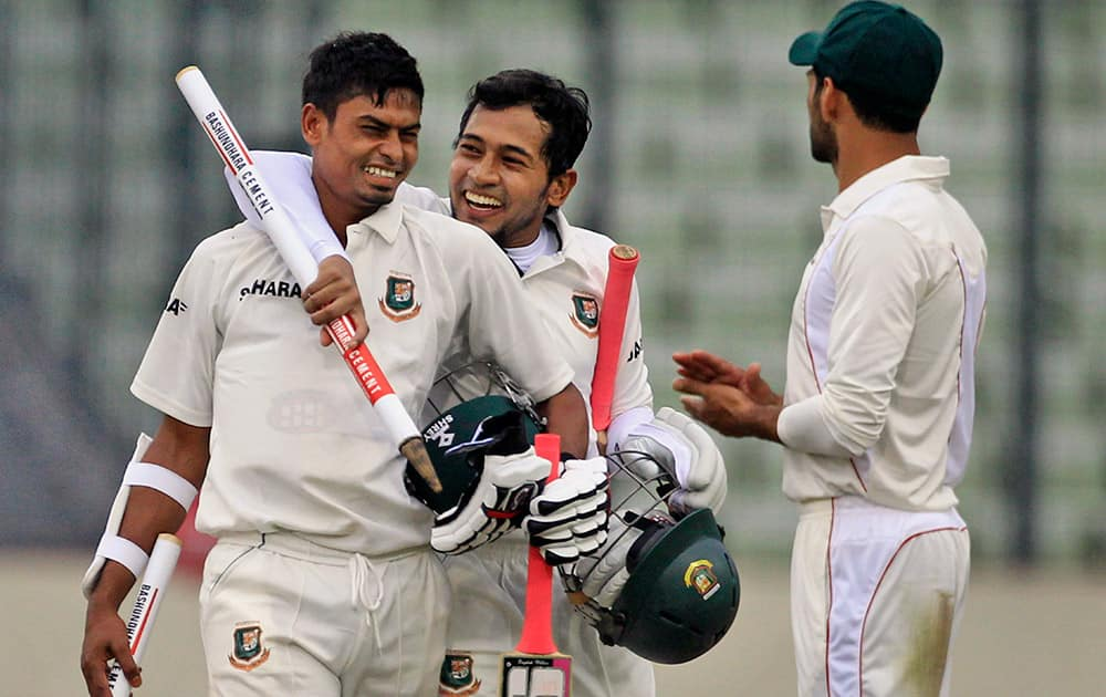Bangladesh's captain Mushfiqur Rahim and Taijul Islam, celebrate after winning the first cricket test match against Zimbabwe in Dhaka, Bangladesh. Bangladesh won by 3 wickets.