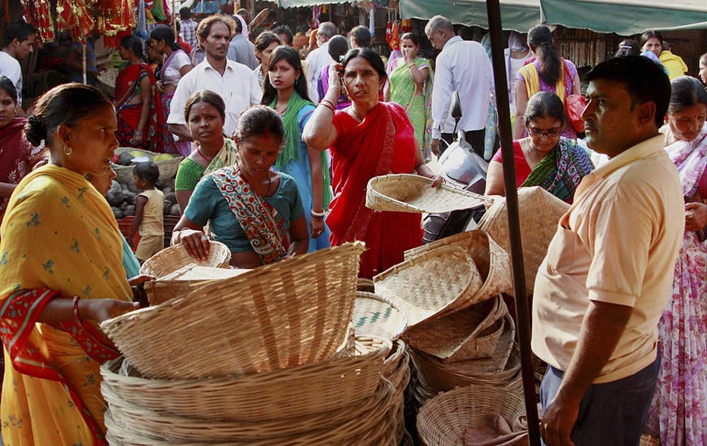 Women purchase bamboo-baskets and other things for the Chhath Puja festival in Gurgaon.