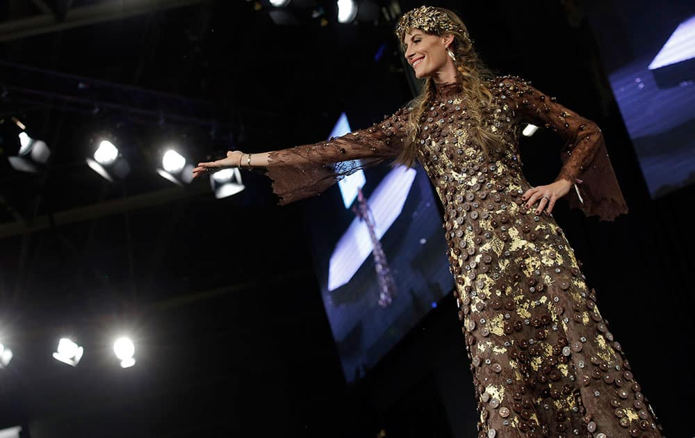 A model presents a chocolate studded dress during a show as part of the chocolate fair in Paris.