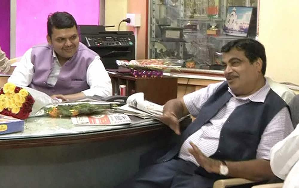 Union Minister for Transport and Shipping Nitin Gadkari interact with Maharashtra BJP state President Devendra Fadnavis on the occasion of Diwali at a party office in Nagpur, Maharashtra.