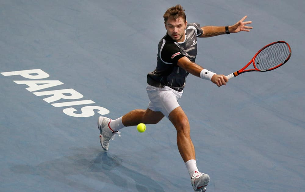 Stanislas Wawrinka of Switzerland, returns the ball to Dominic Thiem of Austria, during their second round match at the ATP World Tour Masters tennis tournament at Bercy stadium in Paris, France.