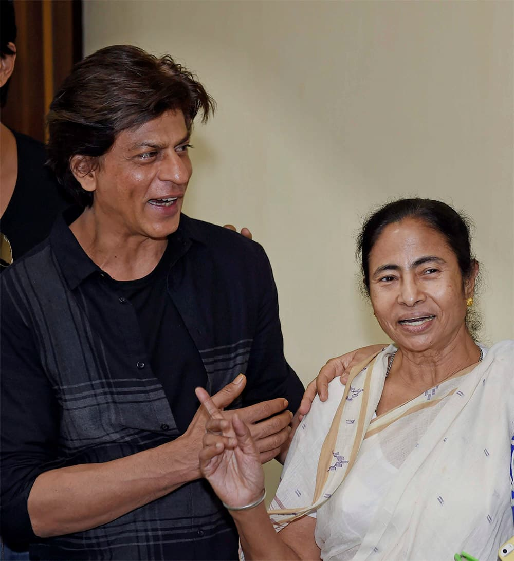 West Bengal Chief Minister Mamata Banerjee with Bollywood actor Shahrukh Khan at a meeting at CM Office in Kolkata. Shahrukh and other star cast of Happy New Year were in Kolkata to promote their film.