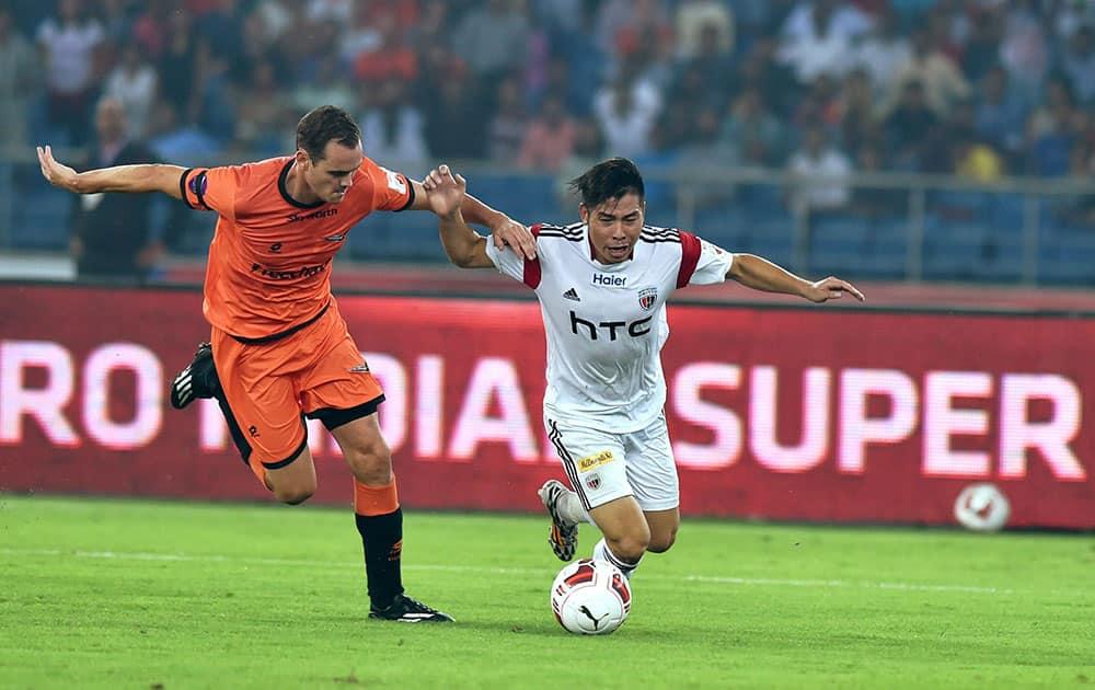 Delhi Dynamos FC player (orange) and NorthEast United FCs Robin Gurung (white) in action during the ISL match at Nehru Stadium in New Delhi.