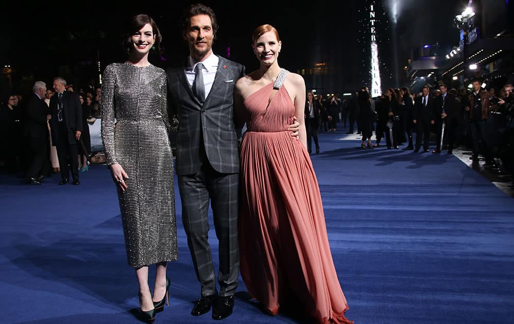 Actors Anne Hathaway, Matthew McConaughey and Jessica Chastain pose for photographers upon arrival at the premiere of the film Interstellar, in central London.