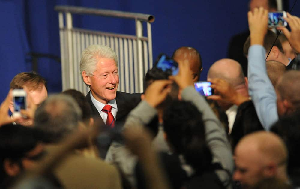 Former President Bill Clinton greets the crowd after speaking at a Get Out the Vote rally in the Oxnard College gym in Oxnard, Calif.