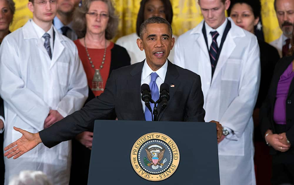 President Barack Obama gestures during remarks at an event with American health care workers fighting the Ebola virus, in the East Room of the White House in Washington.