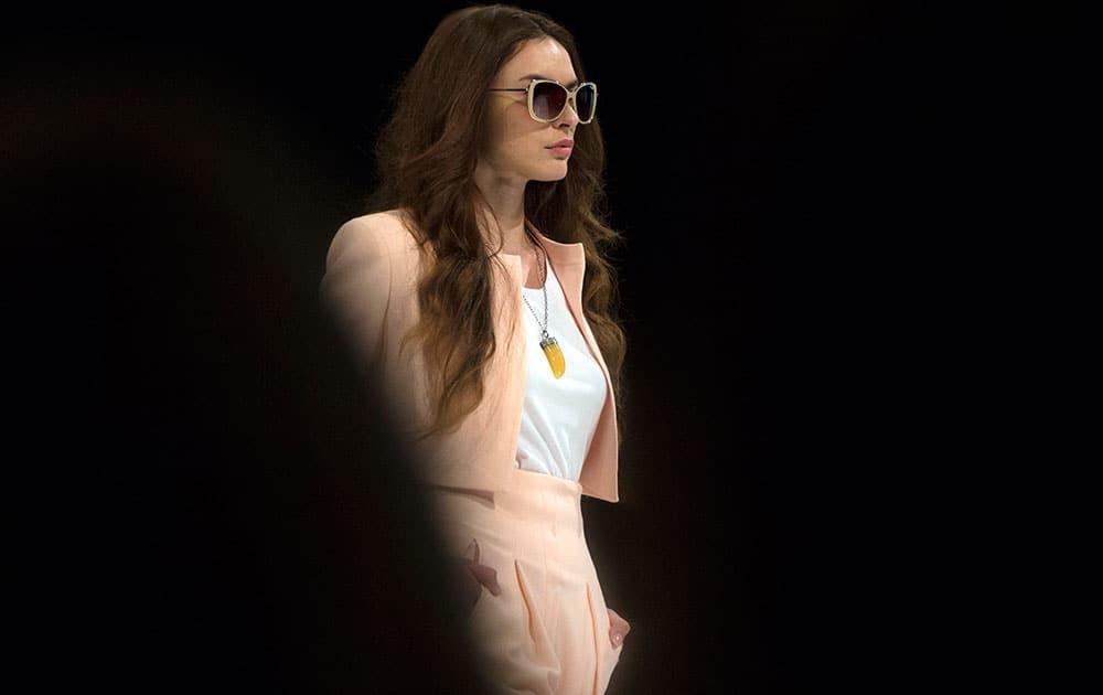 A model displays a creation by Russian designer Valentin Yudashkin during Moscow Fashion Week.