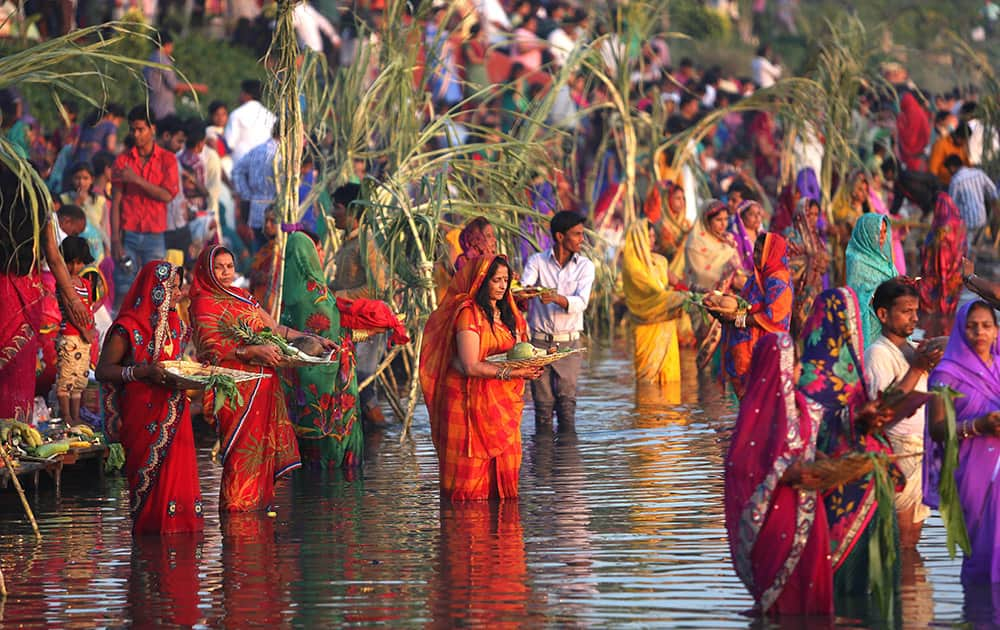 Hindu women perform rituals at sunset to mark Chhath Puja festival in Hyderabad.