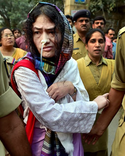 Police escort Irom Sharmila who has been on fast for about 14 years demanding the repeal of controversial Armed Forces Special Powers Act (AFSPA), at Patiala court in New Delhi.