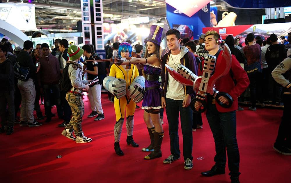 People dressed in costumes attend the Paris Games Week show, in Paris.