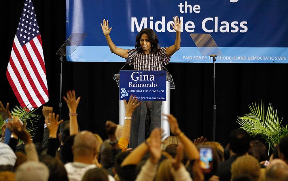 First lady Michelle Obama campaigns for Rhode Island Democratic gubernatorial nominee Gina Raimondo.