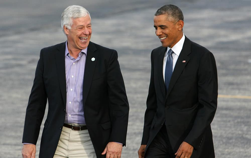 President Barack Obama walks across the tarmac with Maine Democratic gubernatorial candidate, Rep. Mike Michaud, D-Maine after he arrived on Air Force One at the Portland International Jetport, in Portland,