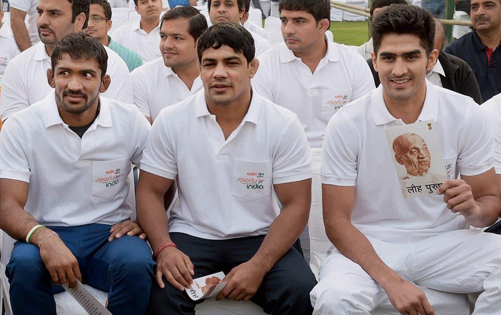 Sportspersons Vijender, Sushil Kumar and Yogeshwar Dutt during the Run for Unity at Rajpath on the occasion of Sardar Vallabhbhai Patels birth anniversary in New Delhi.