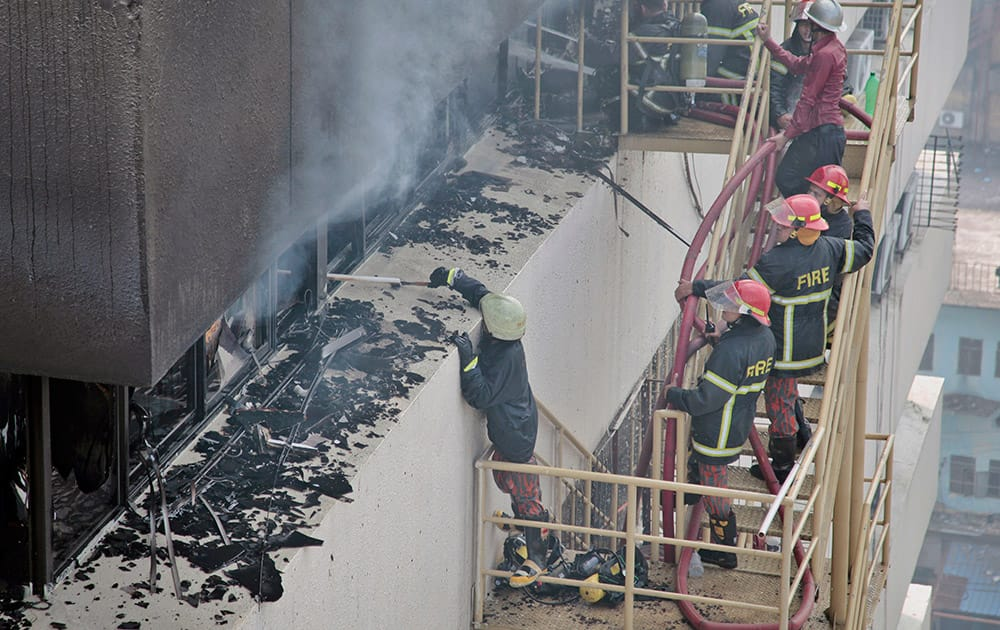 Bangladeshi firefighters work to douse a fire at a building in Dhaka, Bangladesh.