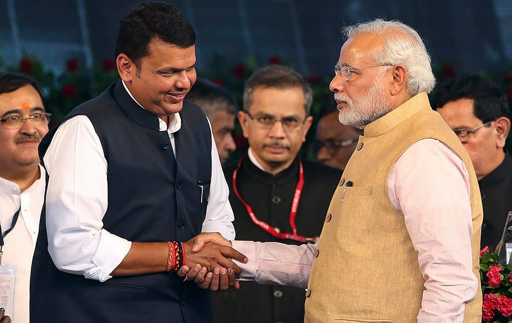 Prime Minister Narendra Modi, greets newly appointed Chief Minister of Maharashtra state Devendra Fadnavis after the swearing in ceremony in Mumbai.
