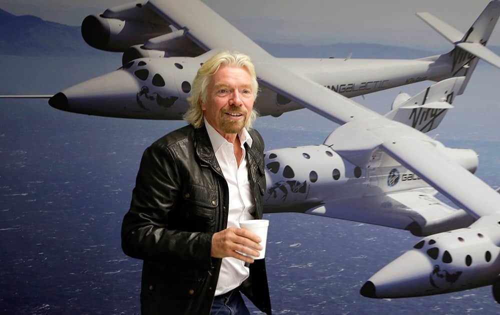 File photo shows British entrepreneur Richard Branson at the Virgin Galactic hangar at Mojave Air and Space Port in Mojave, Calif. Branson is headed to California's Mojave Desert after a Virgin Galactic space tourism rocket exploded and crashed, killing one person and seriously injuring another.