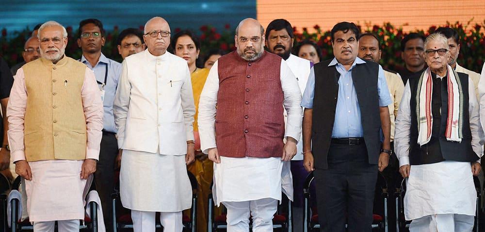 Prime Minister Narendra Modi, BJP President Amit Shah, Union minister Nitin Gadkari and senior leaders LK Advani and MM Joshi at the swearing-in ceremony of new Maharashtra government in Mumbai.