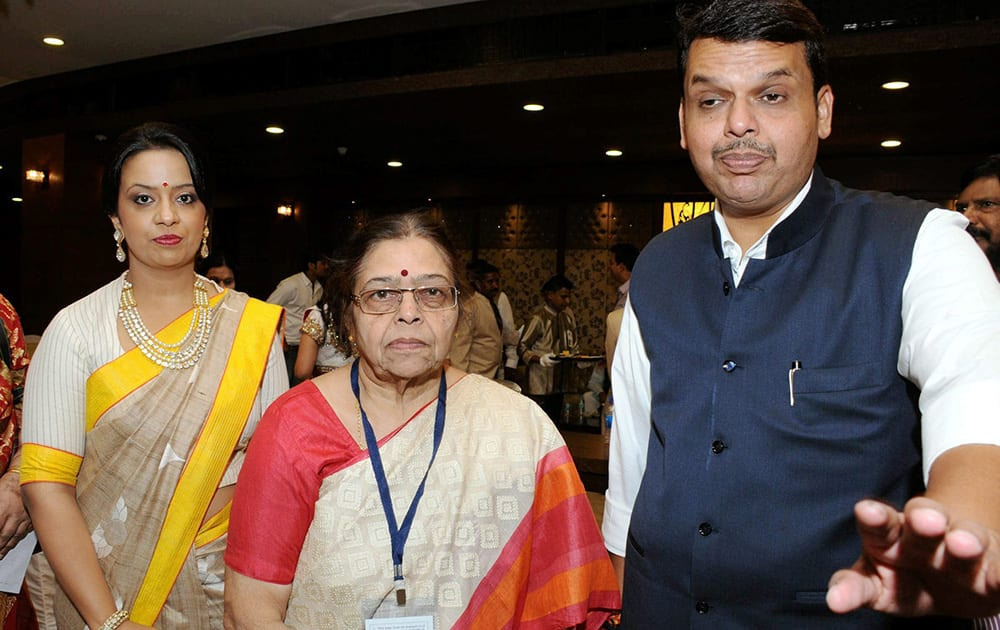 Maharashtra CM Devendra Fadnavis with his mother and wife during the swearing-in ceremony at Wankhede Stadium in Mumbai.