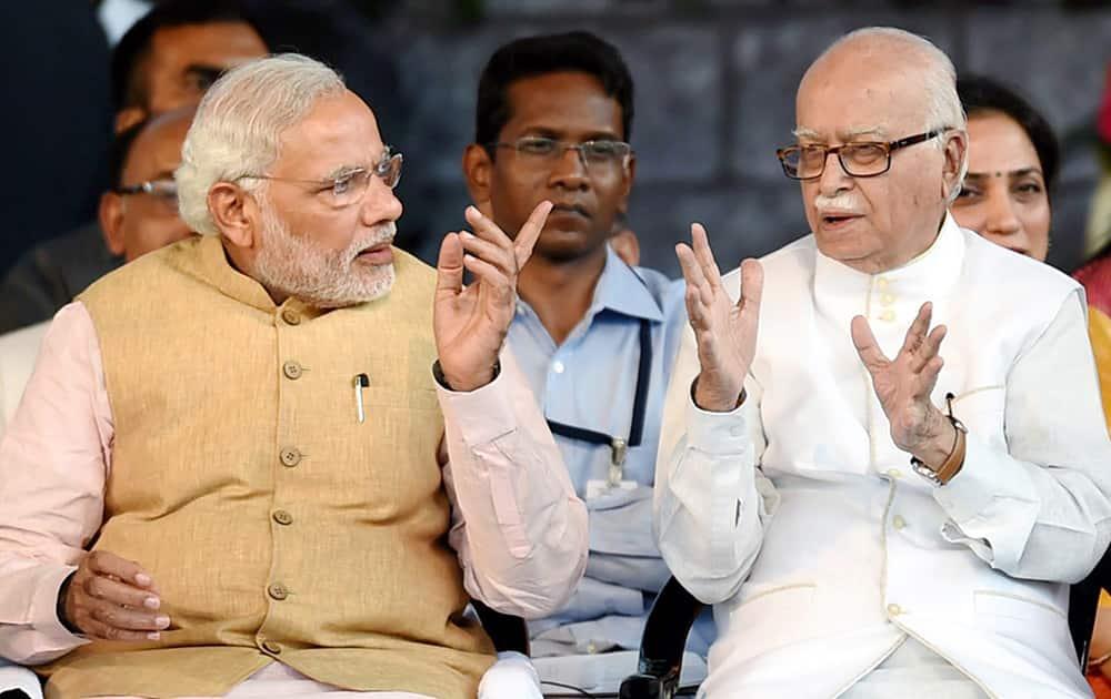Prime Minister Narendra Modi and senior BJP leader LK Advani at the swearing-in ceremony of new Maharashtra government in Mumbai.