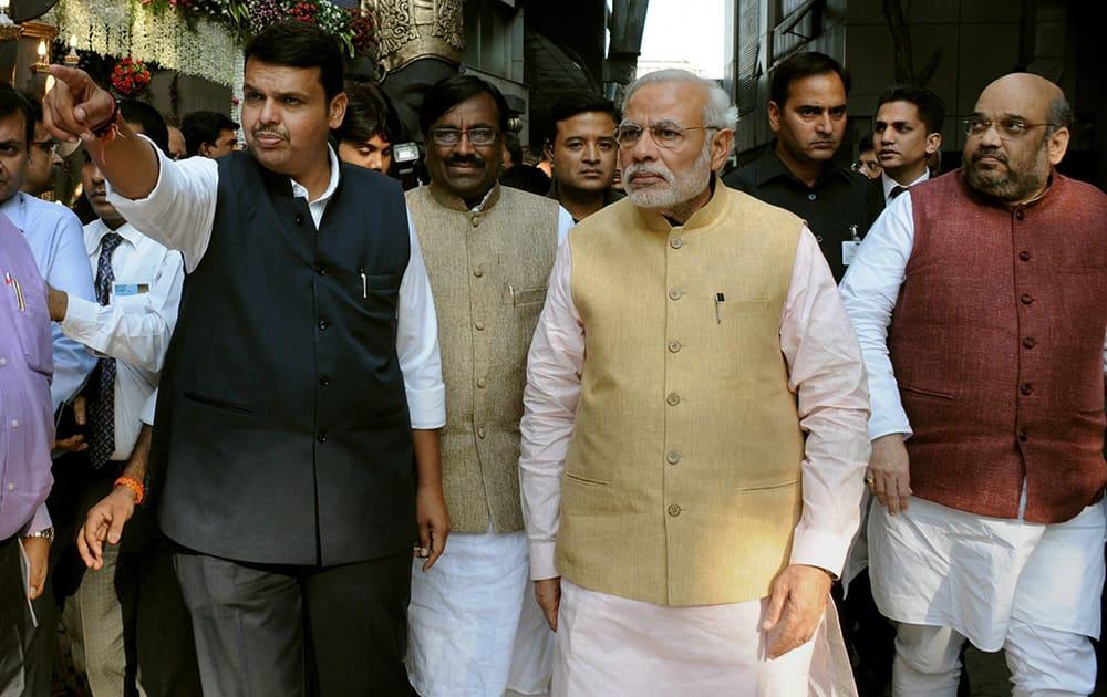 Prime Minister Narendra Modi with Maharashtra CM Devendra Fadanvis (L) and BJP President Amit Shah during the Maharashtra governments swearing-in ceremony in Mumbai.