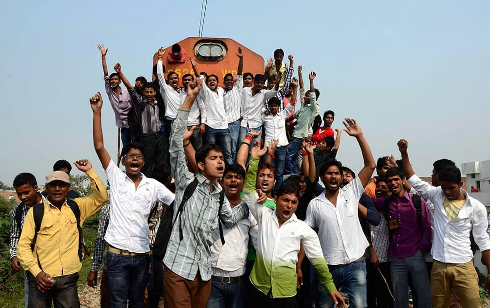 Allahabad University students stop Unchahar Express during a protest demanding their scholarships in Allahabad.