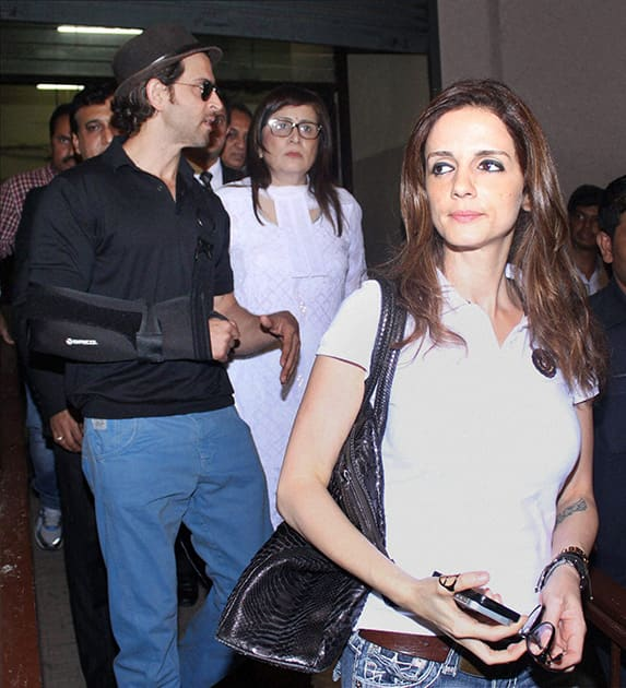 Bollywood actor Hrithik Roshan and Sussane Khan leave the Bandra family court after being granted divorce in Mumbai.