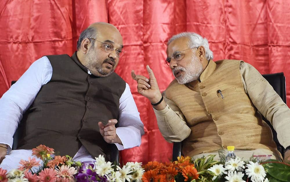 Prime Minister Narendra Modi with BJP President Amit Shah during the launch of Bharatiya Janata Partys (BJP) membership drive at party headquarters in New Delhi.