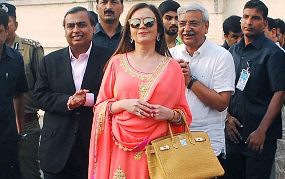 Reliance Foundation Chairperson Nita Ambani and Mukesh Ambani arrive in Varanasi.