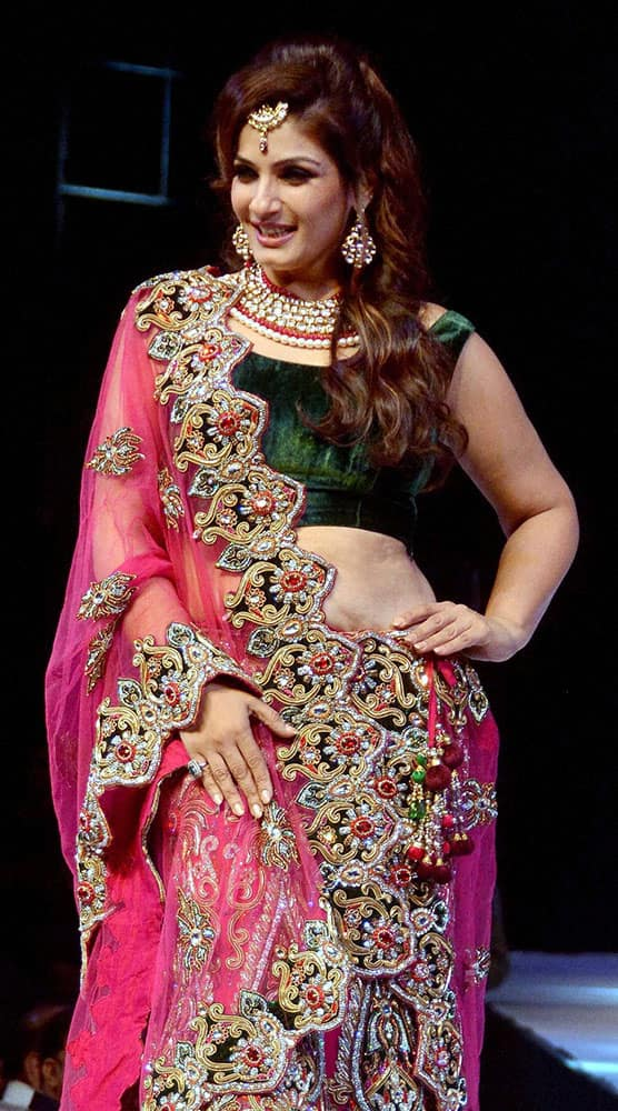 Raveena Tandon walks the ramp at a fashion show in Indore.