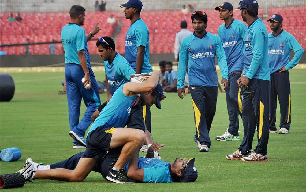 Sri Lankan cricketers during a training session at Barabati Stadium in Cuttack.