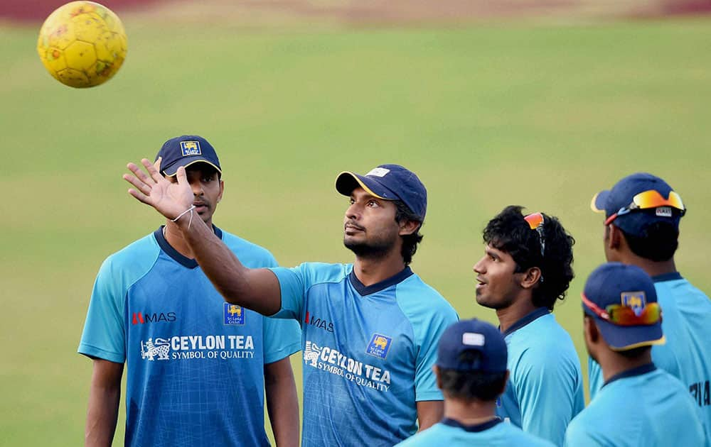 Sri Lankan cricketer Kumar Sangakkara with teammates during a training session at Barabati Stadium in Cuttack.