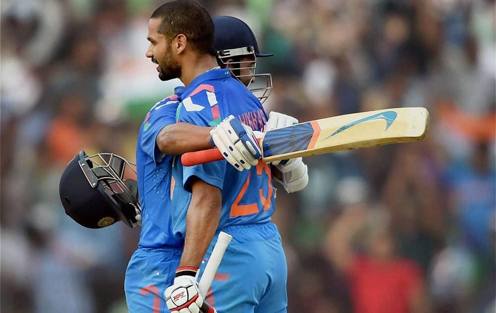 Indian batsman Shikhar Dhawan hugs Ajinkya Rahane after completing his century during 1st ODI match against Sri Lanka in Cuttack.