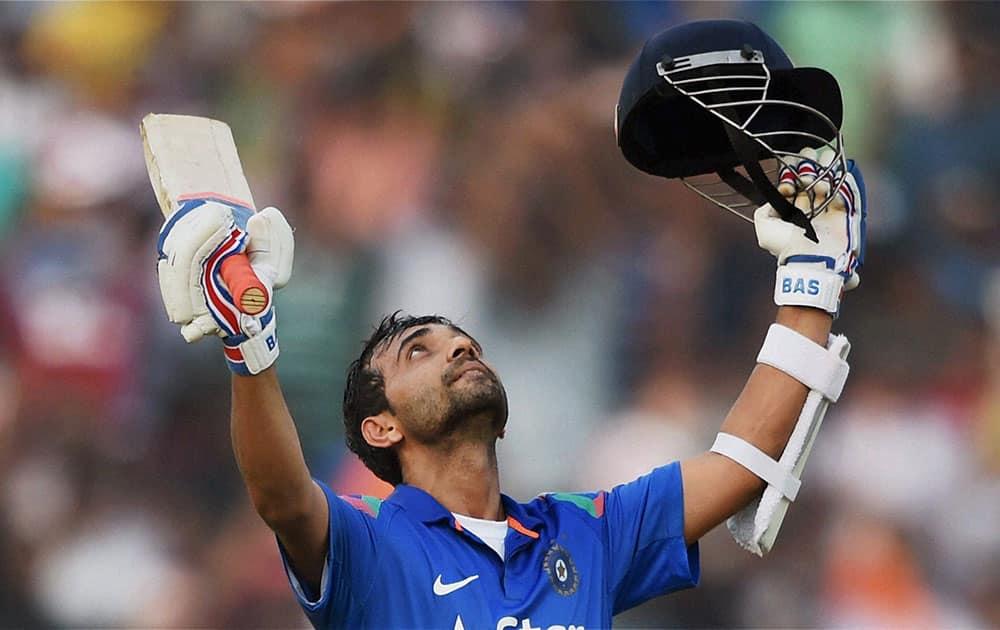 Indian batsman Ajinkya Rahane celebrates his century during 1st ODI match against Sri Lanka in Cuttack.