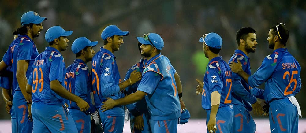 Indian cricketers celebrate after winning 1st ODI match against Sri Lankan in Cuttack.