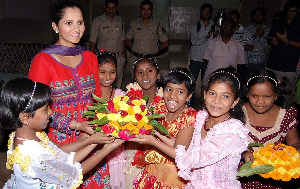 Indian tennis player Sania Mirza meeting with minor girl inmates at a residential hostel Rainbow Home at Musheerabad, Secunderabad.
