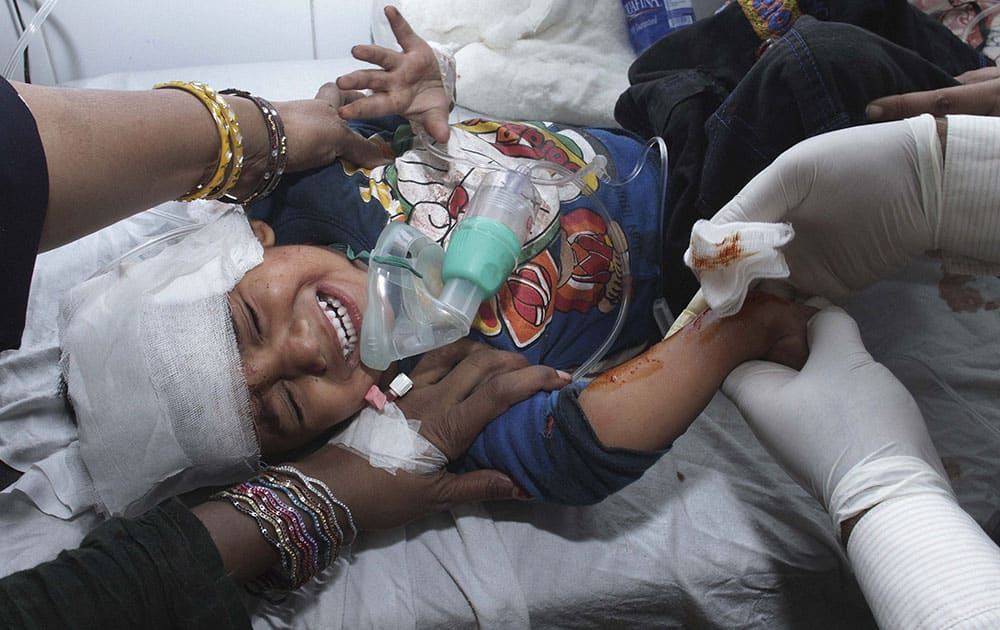A child injured in a bomb explosion receives initial treatment at a local hospital in Lahore, Pakistan.