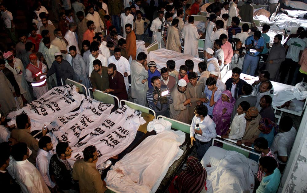 Pakistanis gather to identify bodies of their relatives killed in a bomb blast at a local hospital in Lahore.