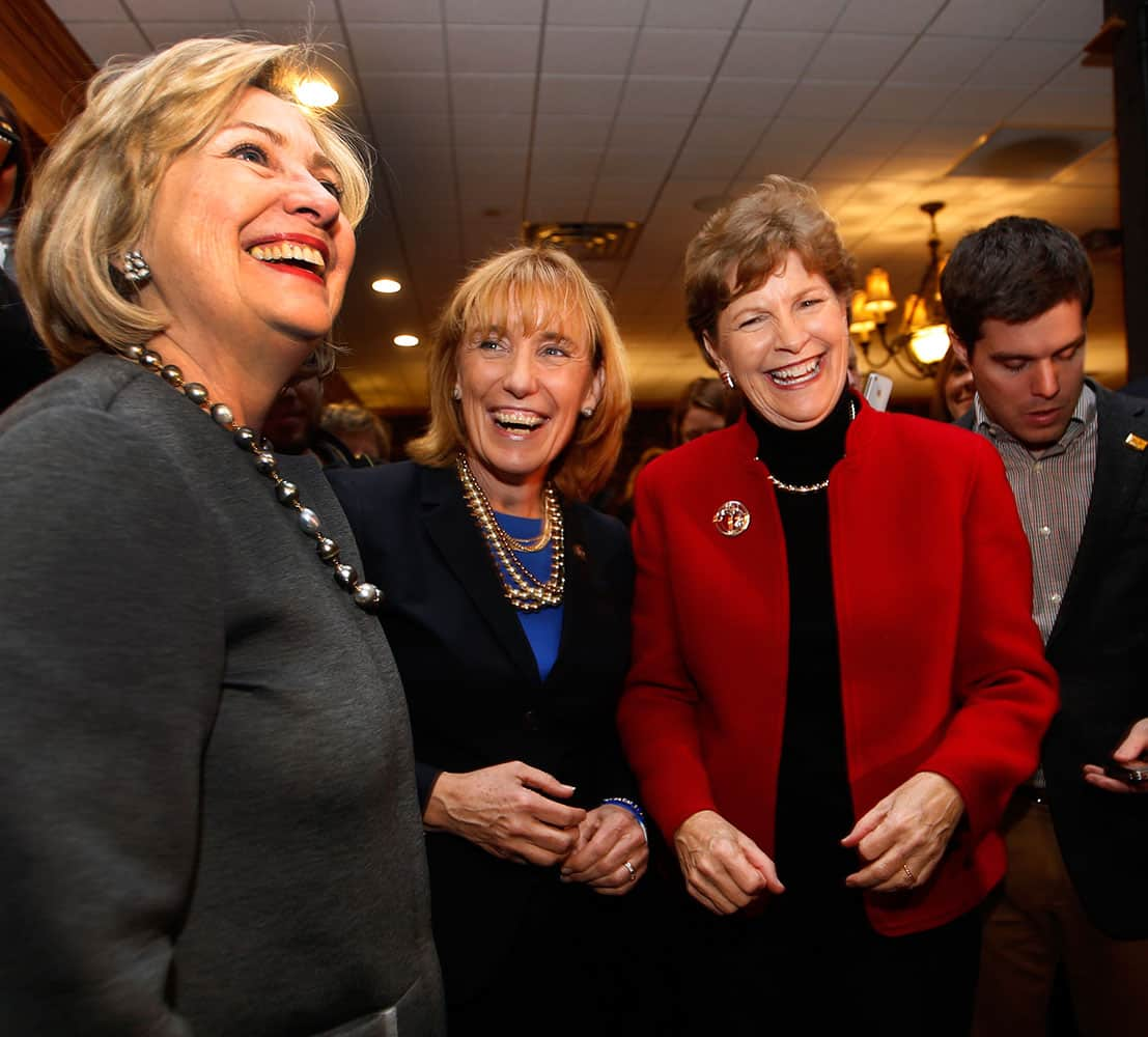 Hillary Rodham Clinton, left, talks to voters with U.S. Sen. Jeanne Shaheen, D-N.H., right, and Gov. Maggie Hassan, D-N.H., at the Puritan Backroom Restaurant, in Manchester, N.H.