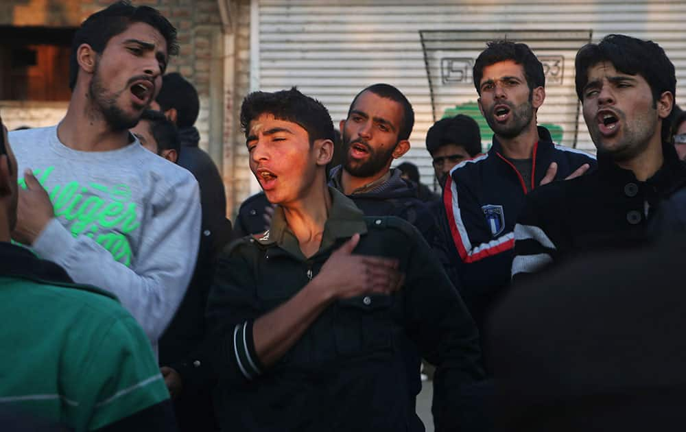 Kashmiri Shiite Muslims beat their chests as they participate in a Muharram procession in Srinagar, India.