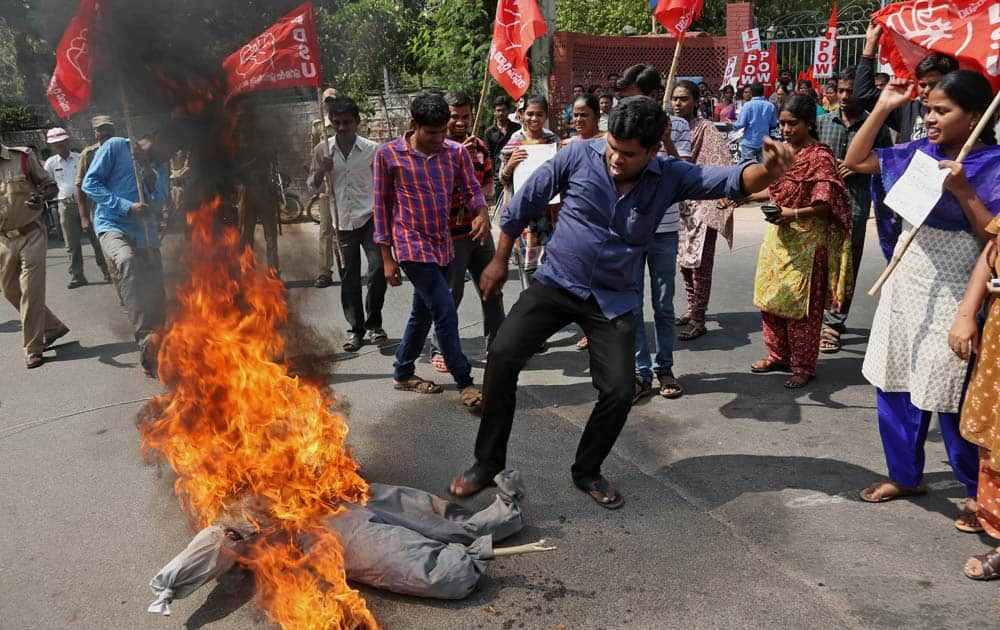Indian students of Progressive Democratic Students Union (PDSU) raise slogans and burn an effigy during a protest against a gang rape of a student, outside the English and Foreign Languages University (EFLU) in Hyderabad, India.