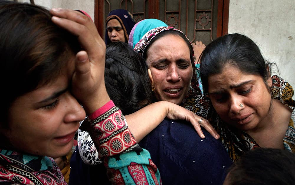 Pakistani women mourn for their family member who was killed in a Sunday suicide bombing, in Lahore, Pakistan.