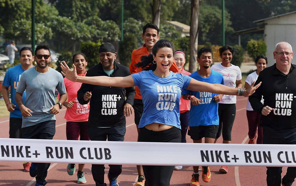 Actress Gul Panag and crickter Parthiv Patel participate in a run after the launch of the Nike Run Club in New Delhi