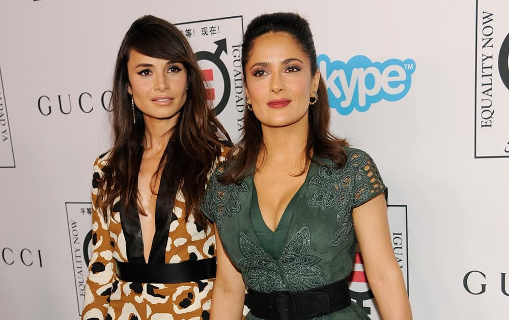 Honoree Salma Hayek Pinault, right, poses with actress Mia Maestro at Equality Now's 'Make Equality Reality' event at the Montage Hotel.