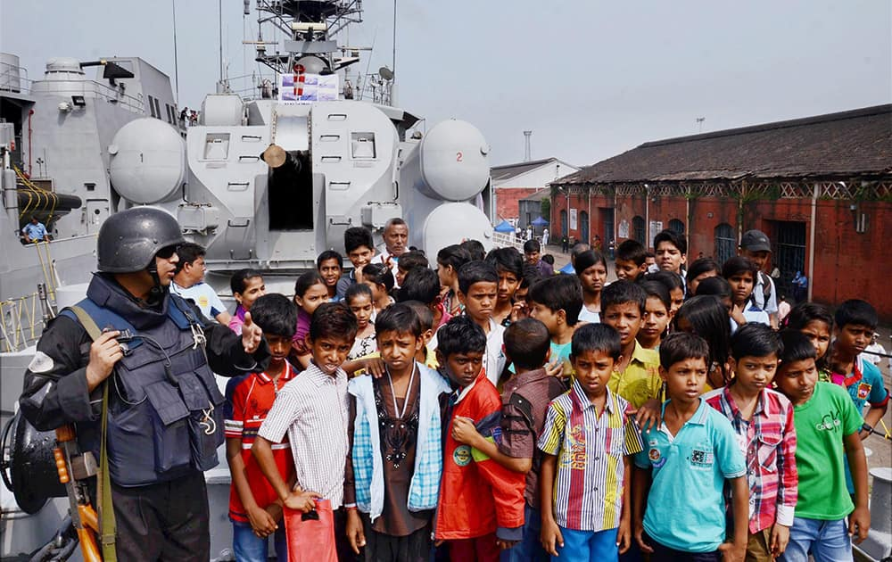 Children visiting INS Khukri at an exhibition organised as part of Navy week celebrations at Khidirpur Dockyard in Kolkata.