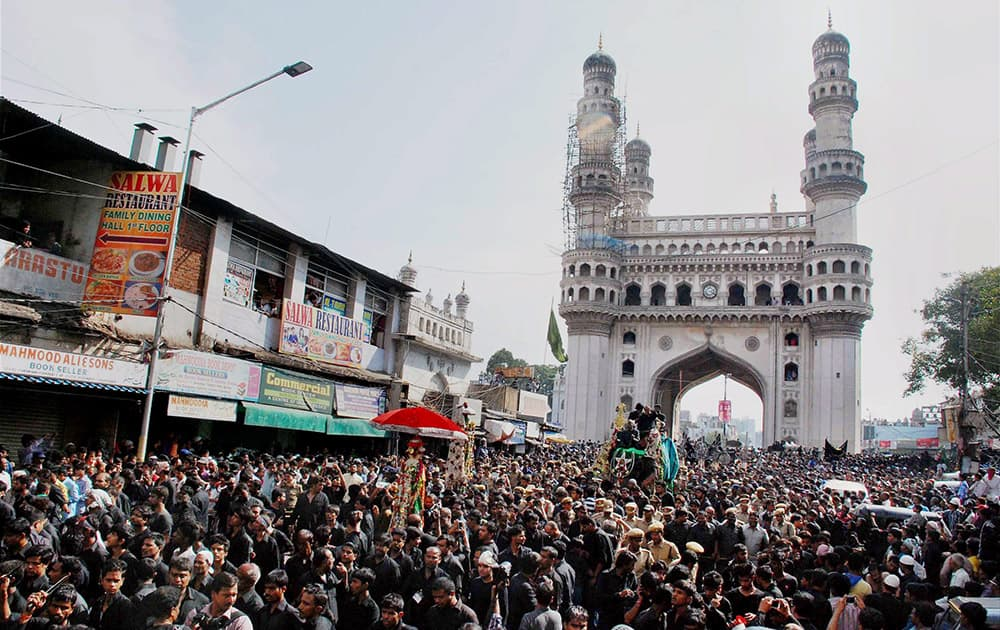 The traditional Bibi Ka Alam procession passes through Charminar in Hyderabad on the 10th day of Muharram.