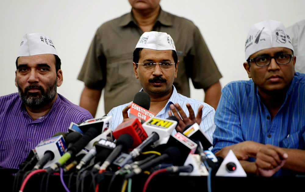 AAP convener Arvind Kejriwal addressing a press conference in New Delhi. Party leaders Gopal Rai and Ashutosh are also seen.